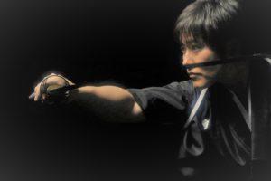 Isao Machii with sword photo